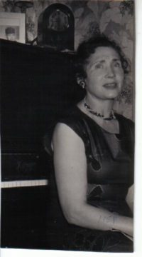 Alice in her new home, with her piano (1957
